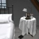 bedside-mesh-table-with-tablecloth-lamp-vase-glass-books