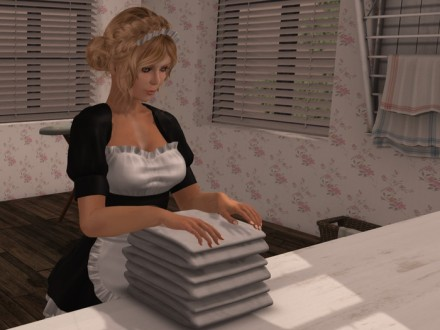 maid folding the laundry